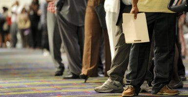 Applicants wait in line to speak with recruiters during a job fair for concession positions at Hartsfield-Jackson International Airport. (Photo: Erik S. Lesser/EPA/Newscom)