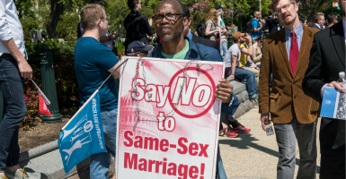 One of the protesters outside the Supreme Court today. (Photo: Brian Cahn/ZUMA Press/Newscom)