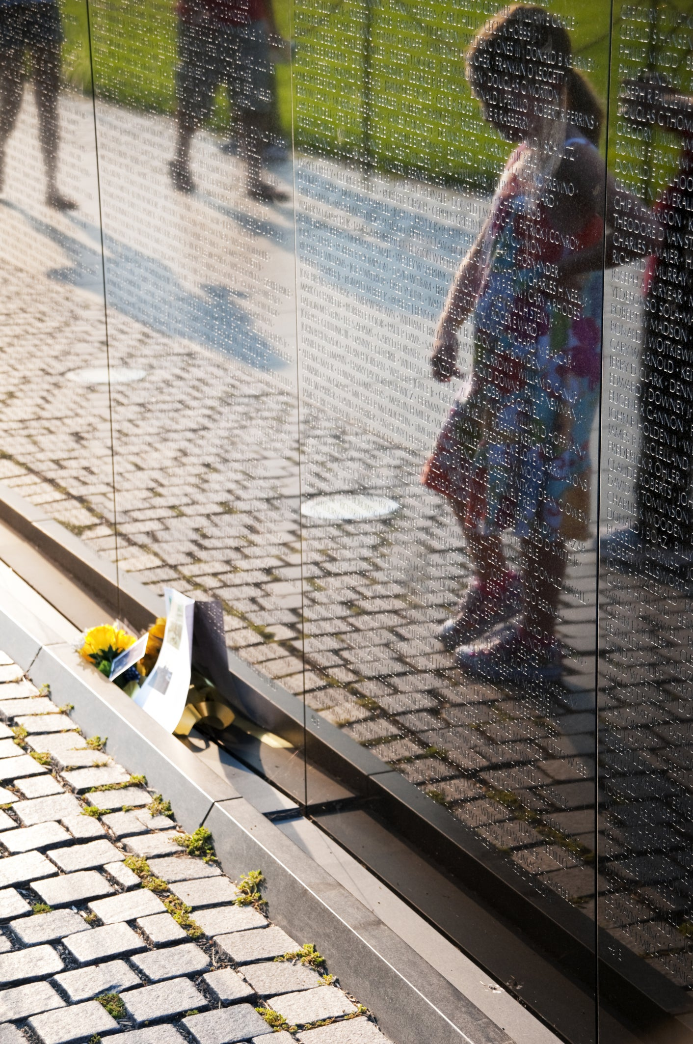 a childs silhouette is reflected in the surface of the vietnam wall photo