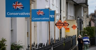 Political party campaign boards outside houses. (Photo: Stefan Rousseau/ZUMA Press/Newscom)