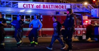 A protestor is arrested at Pennsylvania and North Avenues in Baltimore. (Photo: UPI/Newscom)