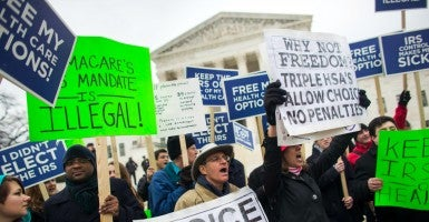 Protesters at the Supreme Court during King v. Burwell hearing. (Photo: Jim Lo Scalzo/EPA/Newscom)