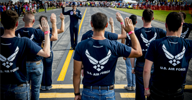Maj. Tyler Ellison, a Thunderbirds pilot, administers the Oath of Enlistment to enlist Florida's newest Airmen. (Photo: U.S. Air Force/Sipa USA/Newscom)