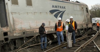 National Transportation Safety Board's Cassandra Johnson works with officials on the scene of the Amtrak train derailment in Philadelphia. (Photo: NTSB/UPI/Newscom)