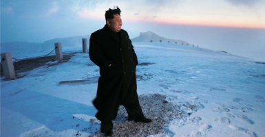 Kim Jong-un poses on top of Mount Paekdu, the highest mountain on the Korean Peninsula, which symbolizes his ancestry. (Photo: Yonhap News/YNA/Newscom)
