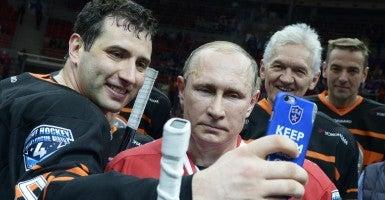 Vladimir Putin poses for a selfie. (Photo: Nikolsky Alexei/ZUMA Press/Newscom)