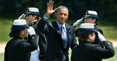 President Obama waves to the crowd as he proceeds to the stage past saluting cadets at the U.S. Coast Guard Academy's 134th Commencement. (Photo: Cloe Poisson/TNS/Newscom)