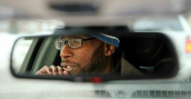 Sean Williams, an Uber driver in Chicago, receives Obamacare subsidies. (Photo: Nuccio DiNuzzo/TNS/Newscom)