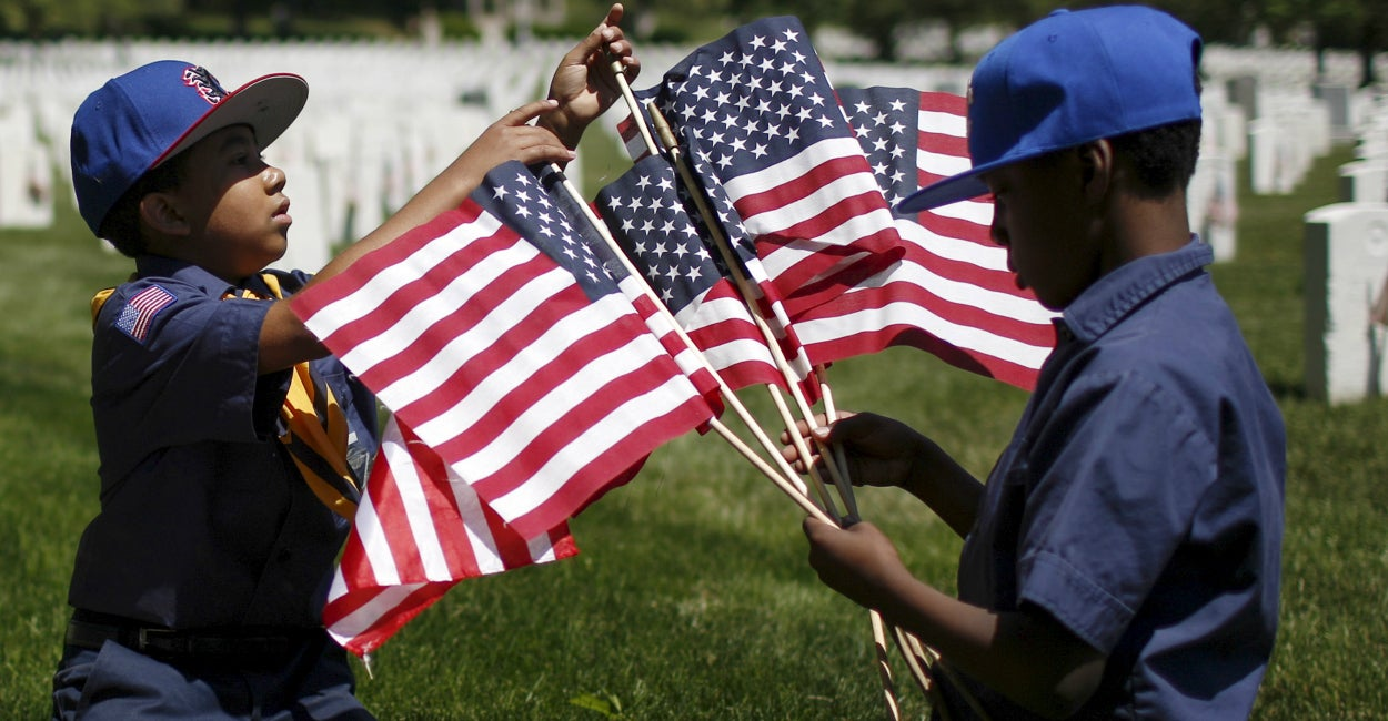 Boy Scouts of America organize U.S. flags to be placed at graves at Cypress Hills National Cemetery in Brooklyn, New York. (Photo: Eduardo Munoz/Reuters/Newscom)