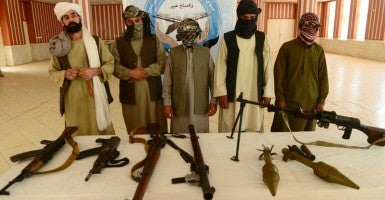 Taliban fighters attend a surrender ceremony in western Afghanistan. (Photo: Sardar Xinhua News Agency/Newscom)