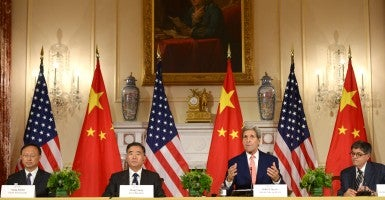 Chinese Vice Premier Wang Yang (2nd L), Chinese State Councilor Yang Jiechi (1st L), U.S. Secretary of State John Kerry (2nd R) and U.S. Treasury Secretary Jacob Lew attend a joint press conference after the seventh China-U.S. Strategic and Economic Dialogue. (Photo: Yin Bogu Xinhua News Agency/Newscom)