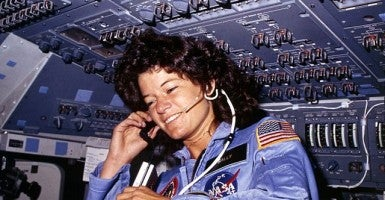 Sally Ride communicates with ground controllers from the flight deck during the six-day mission in Challenger, 1983. Photo credit: National Archives and Records Administration, College Park