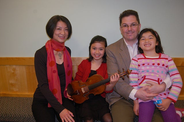 A 2012 photo of the Gagliano family. Avery holds Jieming Tang's Gagliano violin. (Photo: From The Top/Flickr)