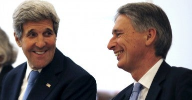 Secretary of State John Kerry  chats with British Foreign Secretary Philip Hammond during a meeting with foreign ministers in Vienna about the Iran deal. (Photo: Carlos Barria/Reuters/ Newscom)