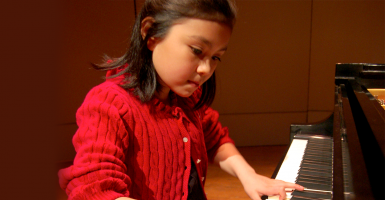 Avery plays the piano at age 10. (Photo: From the Top/Flickr)