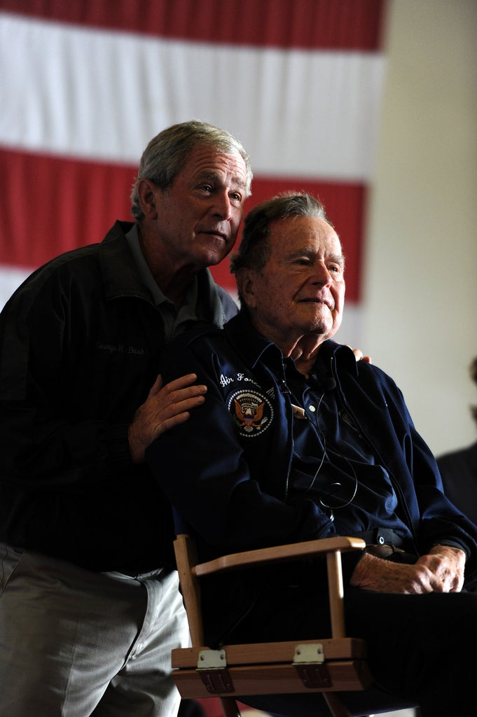 Former Presidents George H.W. Bush and George W. Bush deliver remarks to the crew during a ceremony aboard the aircraft carrier USS George H.W. Bush. (Photo: Official U.S. Navy Page)