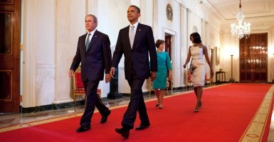 President Barack Obama and First Lady Michelle Obama walk with former President George W. Bush and former First Lady Laura Bush in the Cross Hall towards the East Room of the White House. (Photo: Chuck Kennedy/Creative Commons)