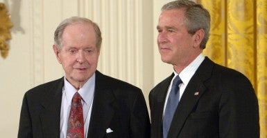 President George W. Bush awards historian Robert Conquest the Presidential Medal of Freedom. (Photo: Roger L. Wollenberg/UPI/Newscom)