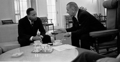 Dr. Martin Luther King, Jr. meeting with President Lyndon Johnson, who signed the Voting Rights Act. (Photo: Agence Quebec Presse/Newscom)