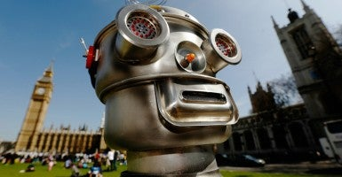 A robot is pictured in front of the Houses of Parliament and Westminster Abbey as part of the Campaign to Stop Killer Robots in London. (Photo: Luke MacGregor/Reuters/Newscom)