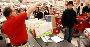Holiday shoppers queue to make their purchases after braving the crowds in Target. (Photo: Getty Images)