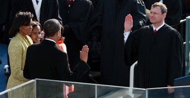 Barack H. Obama is sworn in by Chief Justice John Roberts as the 44th president of the United States. (Photo: Justin Sullivan/Getty Images)