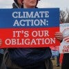 A sign of a liberal activist at the Keystone XL pipeline rally