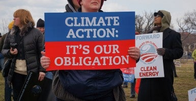 A sign of a liberal activist at the Keystone XL pipeline rally in Washington DC in 2013. (Photo: Nick Bucci/Creative Commons)