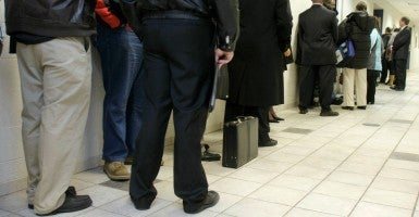 Unemployed Michigan workers stand in line for a job fair. (Photo: Getty Images)