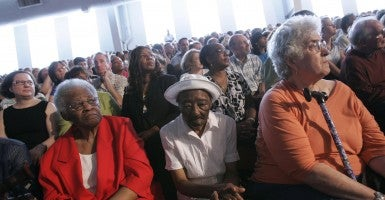Women listen to U.S. President Obama speak during a town hall on healthcare reform in 2009 at Shaker Heights high school in Shaker Heights, Ohio.  (Photo:  J.D. Pooley/Getty Images)