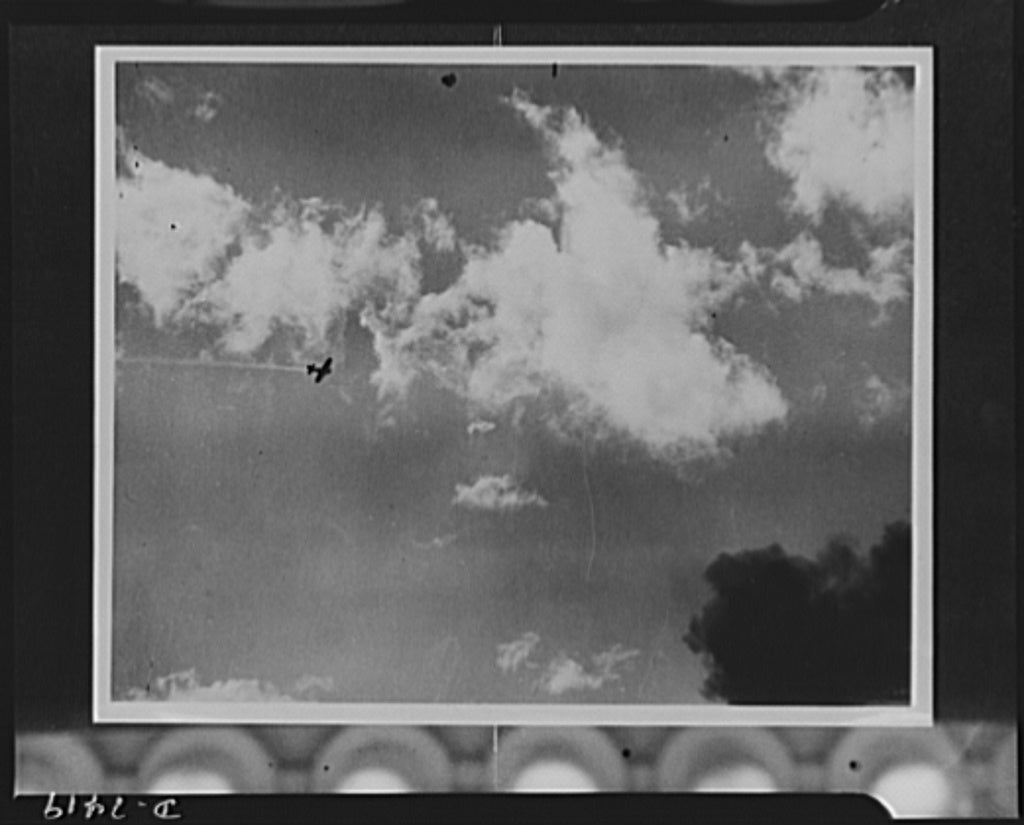The Japanese bomber, a thin line of smoke trailing in the wake, was struck by anti-aircraft fire during the attack on Pearl Harbor. (Photo: Library of Congress Prints and Photographs)