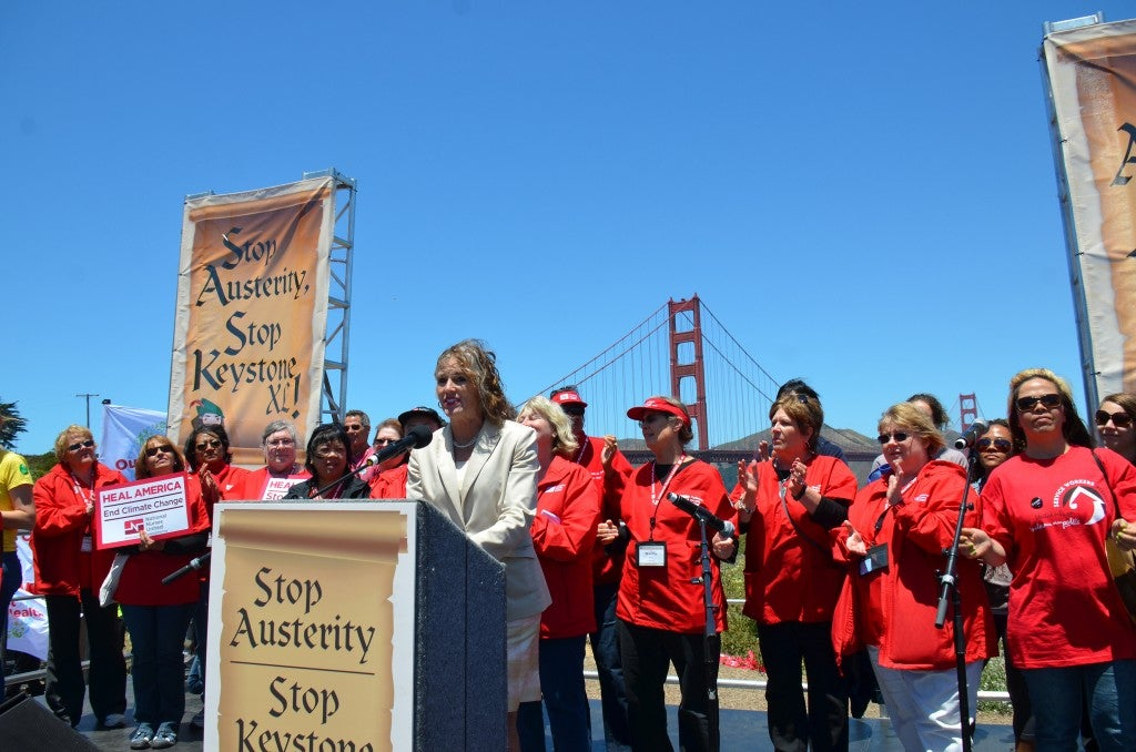 Steyer's wife, Kathryn Taylor, with hundreds of nurses after a march across the Golden Gate Bridge to protest Keystone XL pipeline and austerity. (Photo: Steve Rhodes/Creative Commons)