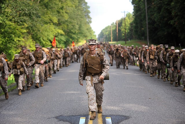 A Marine supervises from the center of The Basic School permanent personnel battalion during a 10-mile hike aboard the westside of Marine Corps Base Quantico, Va. (Photo:  Lance Cpl. Cuong Le/Released)