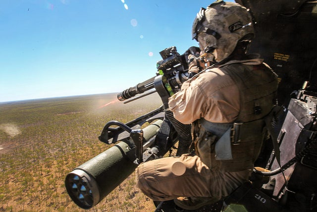 Sgt. Brian D. Richardson, a 29-year-old crew chief for Marine Medium Tiltrotor Squadron 265 (Reinforced), 31st Marine Expeditionary Unit, fires a 7.62mm GAU-17/A weapon system at enemy targets from a UH-1Y Venom helicopter during live-fire training as part of Exercise Koolendong. (Photo: Sgt. Paul Robbins/Released)