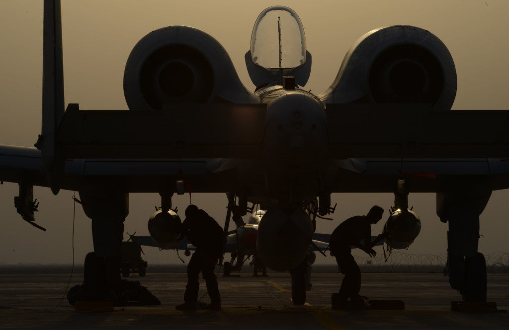 U.S. Air Force airmen work on an A-10 Thunderbolt II from the 163rd Expeditionary Fighter Squadron. Since their arrival to the 332nd Air Expeditionary Group, A-10s have expended nearly 50,000 rounds of ammunition and dropped approximately 500 bombs and maverick missiles in support of Operation Inherent Resolve. (Photo: Tech. Sgt. Jared Marquis/U.S. Air Force)