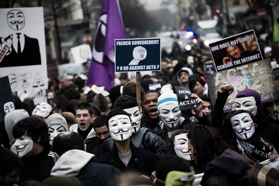 Activists in France protest in support of Anonymous and in opposition to the Anti-Counterfeiting Trade Agreement.