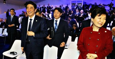 Japanese Prime Minister Shinzo Abe and South Korean President Park. Geun Hye (Photo: Kyodo/Newscom)
