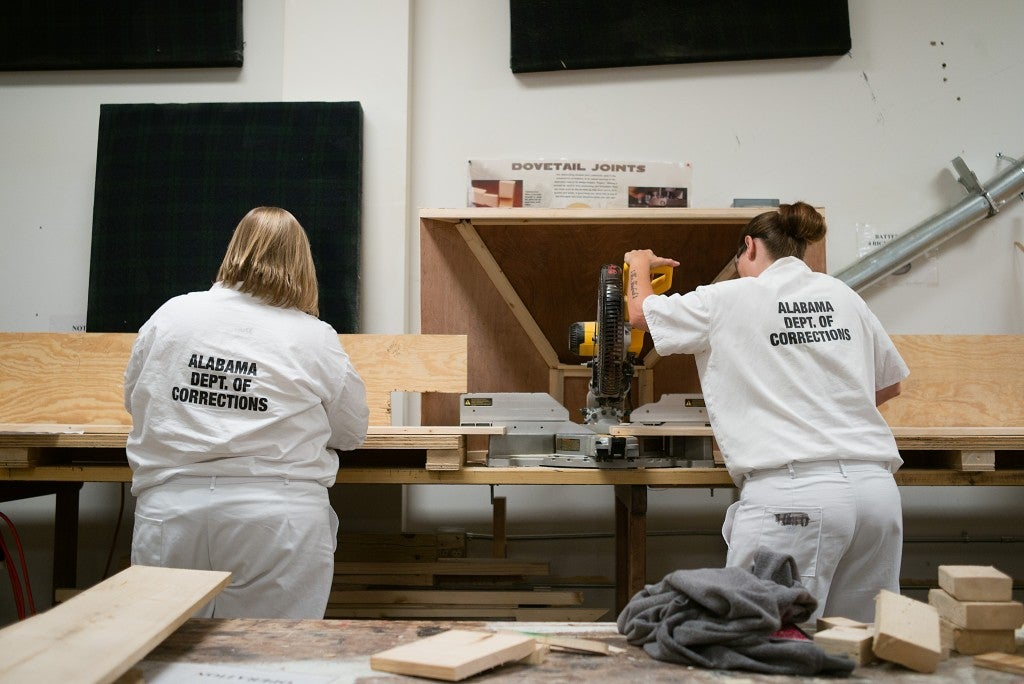 Female residents learn carpentry skills in the wood shop at the Alabama Therapeutic Education Facility, a medium security prison known for its alternative treatment options. (Photo: Bob Miller for The Daily Signal)