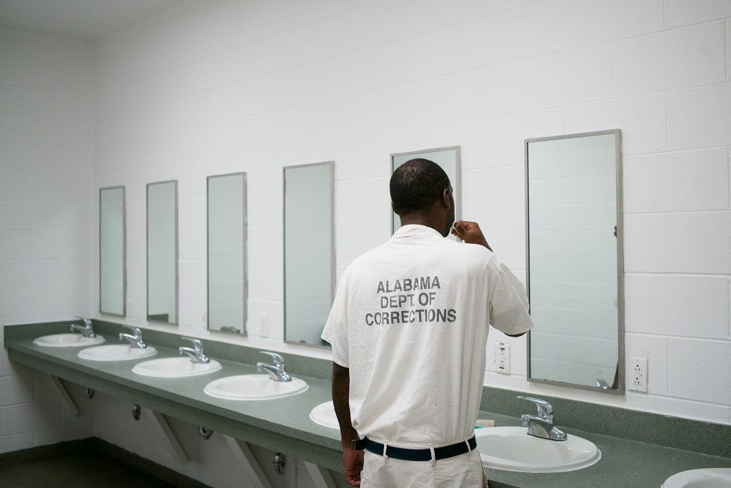 "A resident brushes his teeth at the Alabama Therapeutic Education Facility, an alternative prison that strives to ""break the cycle of recidivism."" (Photo: Bob Miller for The Daily Signal)"