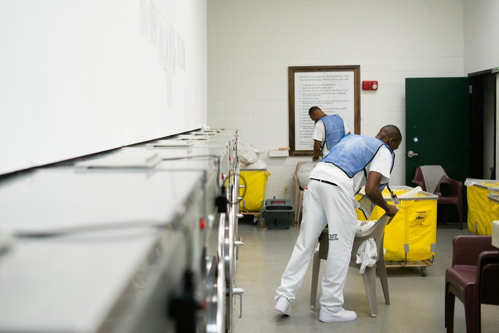 Residents perform laundry duty at the Alabama Therapeutic Education Facility, a privately-run, medium security prison in Columbiana. (Photo: Bob Miller for The Daily Signal)