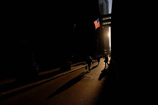 American flag in shadows of city street in New York