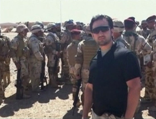 Iranian-American Amir Mirza Hekmati, who has been sentenced to death by Iran's Revolutionary Court on the charge of spying for the CIA, stands with U.S. soldiers in this undated still image taken from video in an undisclosed location made available to Reuters TV on January 9, 2012.