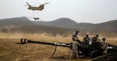 Soldiers assigned to 2nd Stryker Brigade Combat Team, 25th Infantry Division, conduct air assault sling load training on Warrior Base, New Mexico Range, in the Demilitarized Zone, Republic of Korea, March 18, 2015, during joint training exercise Foal Eagle 2015. (Photo: U.S. Army photo by Spc. Steven Hitchcock)