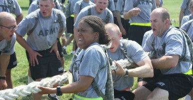 Officer Candidates participate in a tug-of-war competition as part of a team building and physical training session during Phase I Officer Candidate School (Photo: The U.S. Army / Flickr / CC BY 2.0)