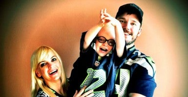 Chris posted this photo of his son and wife, Anna Faris from his Twitter account (@PrattPrattPratt) on Thanksgiving with the caption '#HappyThankgiving #12thMan.'