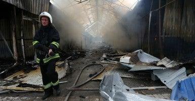 A firefighter seen at the Sokol market after a shelling attack (Photo: Sokolov Mikhail/ZUMA Press/Newscom)