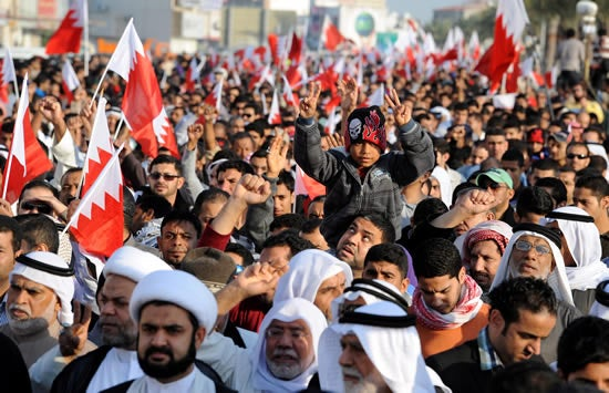 Bahraini pro-reform protesters march during a rally in Maksha village west of the Bahraini capital Manama on December 30, 2011.