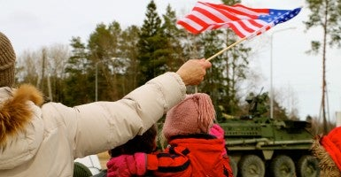 The U.S. Army Stryker convoy makes a stop in Latvia, March 22. (Photo: Nolan Peterson/The Daily Signal)