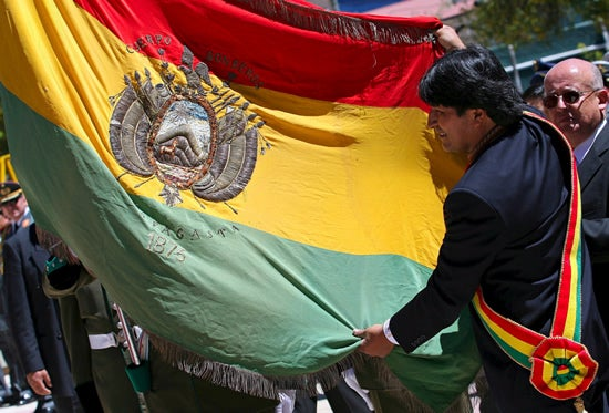 Bolivian President Evo Morales holds the national flag during the celebration of the 128th anniversary of the death of Eduardo Abaroa, in the capital La Paz, Friday 23 March 2007.