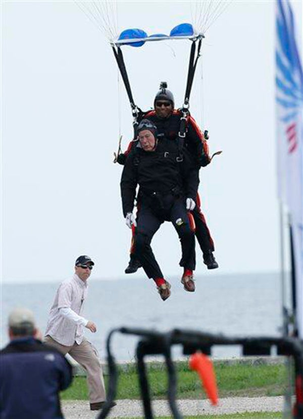 Bush lands after making a parachute jump on his 90th birthday. (Photo: The Eagle via Twitter)